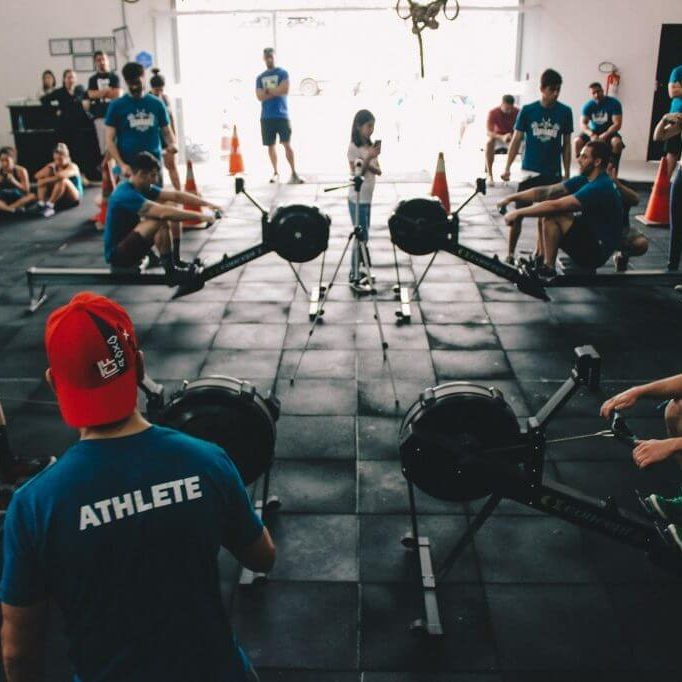 group of people exercising on a gym
